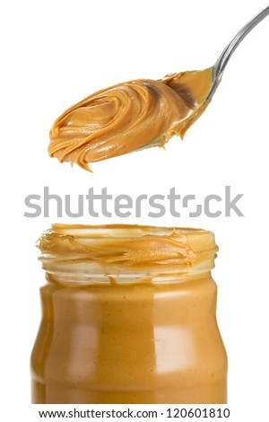 Peanut butter in jar with spoon - stock photo