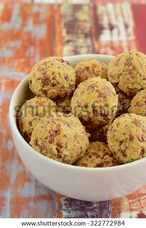 Peanut butter oatmeal flax seeds energy balls in a bowl