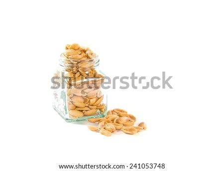 peanut in a glass bottle isolated on white background