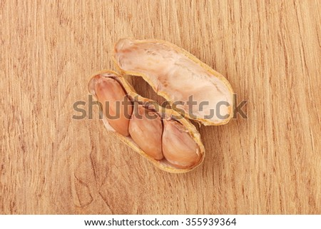 Peanut in shells on wood background