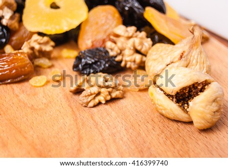 peanuts honey, candied roasted nuts, Grilyazh, dried fruits, dried pineapple, dried figs, walnuts, prunes, figs, dried apricots, candied roasted nuts on the desk  - stock photo