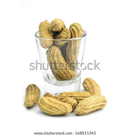 Peanuts in a glass isolated on white background.Close up,Macro photography.