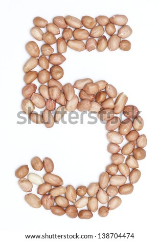 Peanuts in shape of letter 5 - stock photo