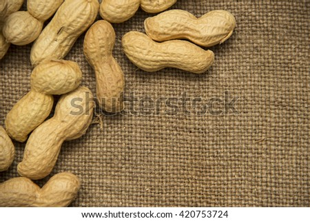 Peanuts on brown canvas background