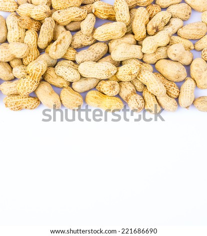 Peanuts pile on a white background. - stock photo