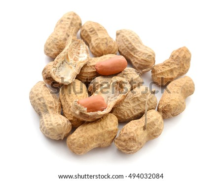 Peanuts with leaves close up on white