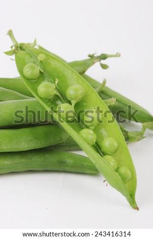 Peapod shows peas - stock photo