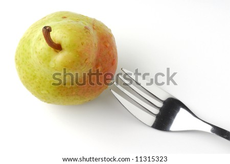 Pear and fork studio isolated on white background