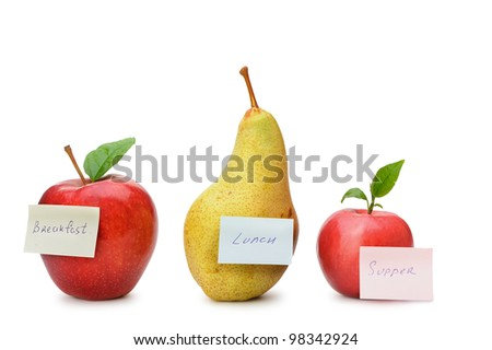 Pear and red apples with paper notes. Inscriptions on the notes Breakfast, lunch and dinner. The concept of diet - stock photo