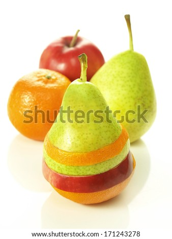 Pear dressed in pieces of different fruits next to them