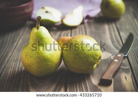 pear fruits close up shoot on wooden table with kitchen accessories