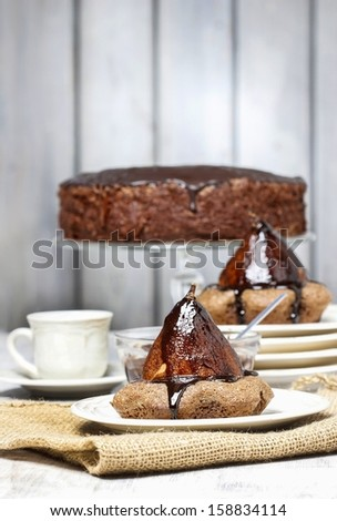 Pear in cake with chocolate sauce - stock photo