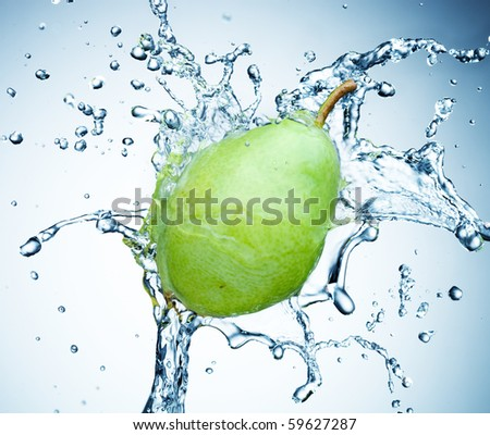 pear in spray of water. Juicy pear with splash on white background