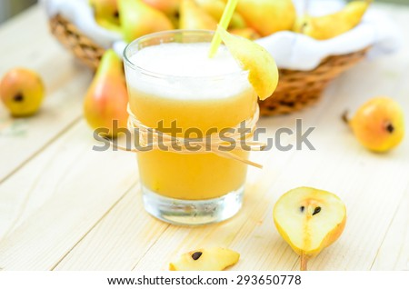 Pear Juice with fresh fruits on wooden boards