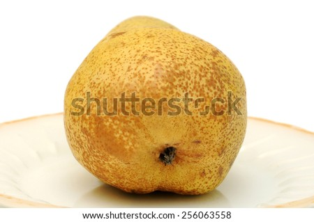 Pear on a saucer with golden border.