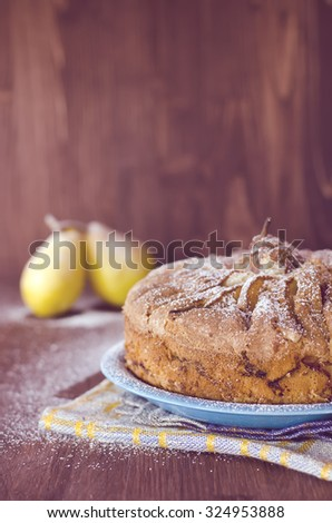 Pear pie with pears on the wooden background,  selective focus, toned photo