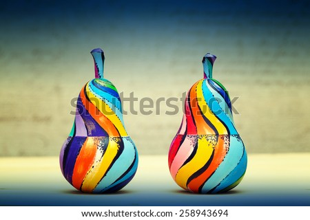 Pear wood - colored paints by hand. Modern art, eco items, decorative fruits - stock photo