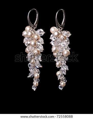 Pearl and crystal earrings on black isolated, a lot of copyspace available
