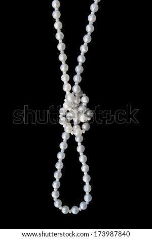 Pearl bead knotted on black background - stock photo