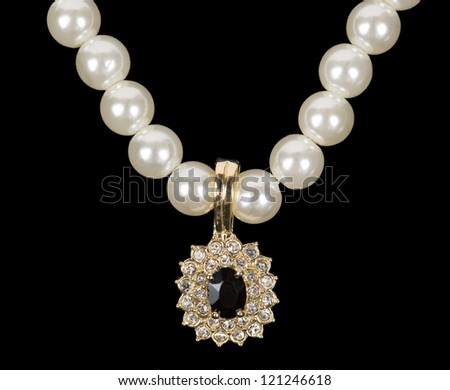 pearl beads and a gold pendant. Isolate on white background. - stock photo