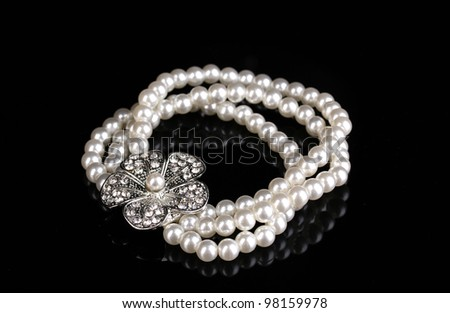 Pearl bracelet isolated on black - stock photo