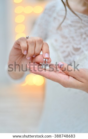 pearl earring in hands