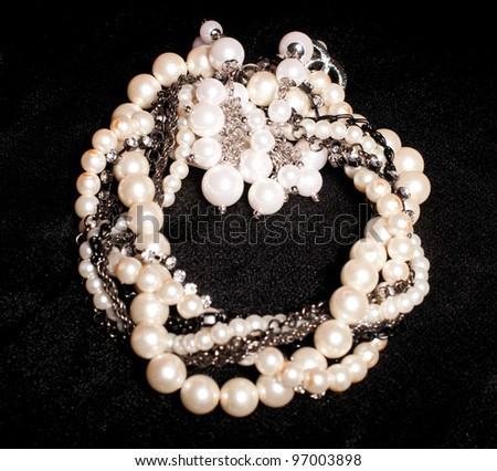 Pearl jewelry on black background