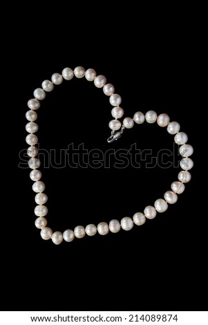 Pearl necklace in the shape of a heart isolated over black - stock photo