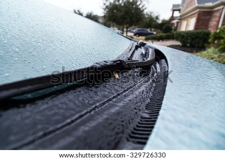 Pearland, TX/USA - 01 24 2014: Ice on frozen car windshield during rare Ice Storm in Houston, TX area