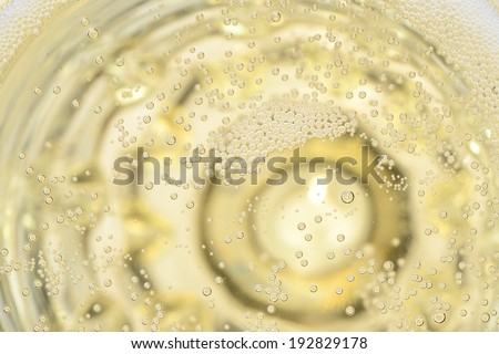 pearls in champagne and glass macro view - stock photo