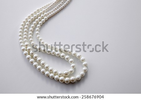 pearls necklace on the white background - stock photo