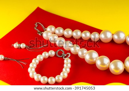 Pearls on yellow, red background