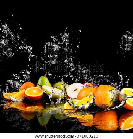 Pears, apples, orange  fruits and Splashing water - stock photo