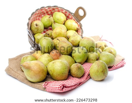 Pears in a basket and on burlap, isolated on white