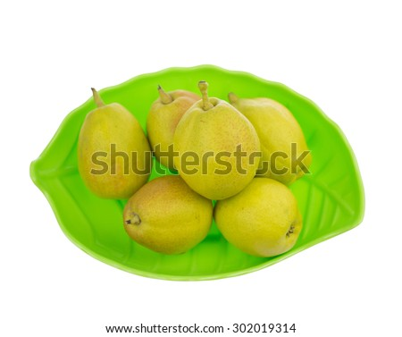 pears in plate isolated on white background  - stock photo