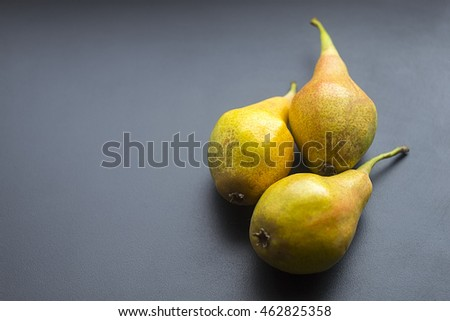 pears on a dark background