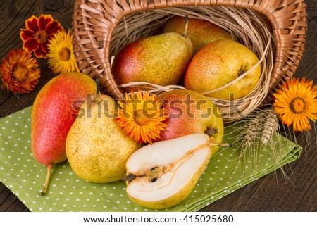 Pears on green napkin. Autumn fall still life. - stock photo