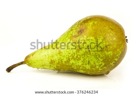 pears one on white background / One green pear isolated on white background / Single green ripe pear isolated on white background / Front view of conference pear isolated on white - stock photo