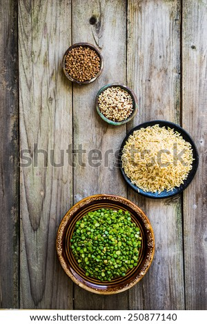 Peas,brown rice,quinoa and buckwheat on wooden background - stock photo