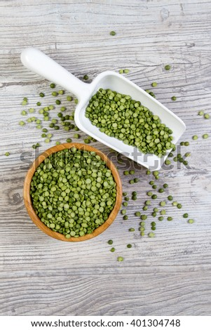 Peas in bamboo bowl with white juice - stock photo