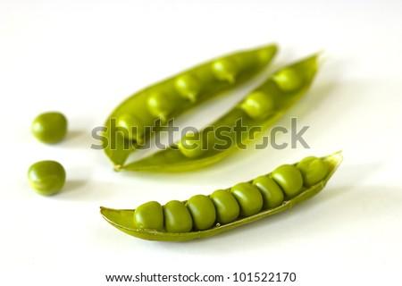 Peas isolated on white - stock photo