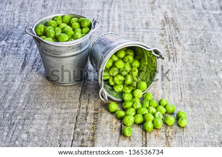 Peas out of a container - stock photo