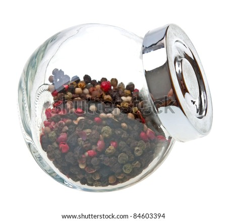 Peas pepper in a glass jar isolated on white background