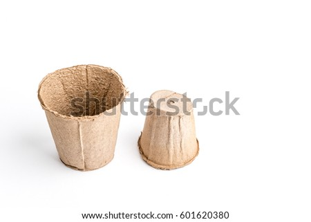 Peat pot for seedling it is isolated on a white background .