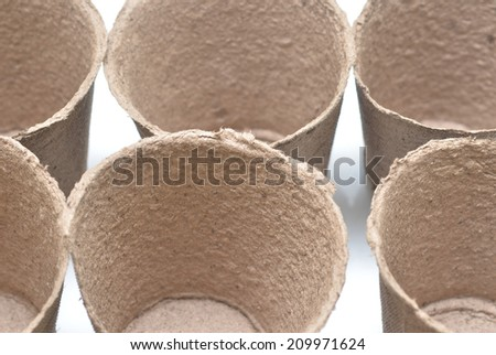 Peat pots for growing seedlings isolated on white background - stock photo