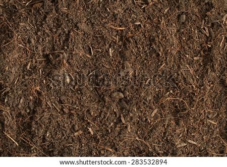Peat soil texture background - stock photo