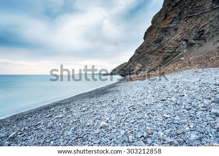 Pebble beach at Millook Haven on the north coast of Cornwall - stock photo
