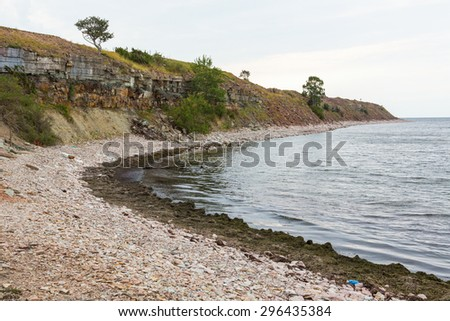 Pebble beach by the sea - stock photo