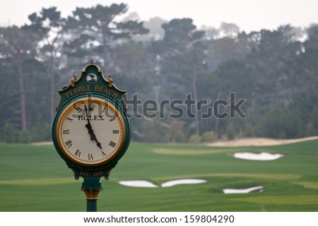 PEBBLE BEACH, CA - OCTOBER 19: Famous Rolex clock located on the Pebble Beach golf course October, 19 2013 in Pebble Beach, California. The golf course will once again host the 2019 U.S. Open. - stock photo
