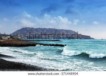 pebble beach ocean, Lima, Peru - stock photo